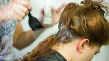 Woman having hair dyed at salon